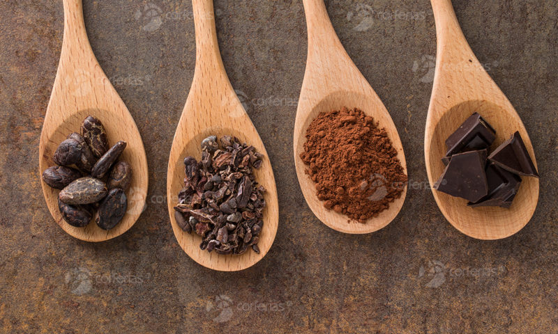 the cocoa and dark chocolate in wooden spoons
